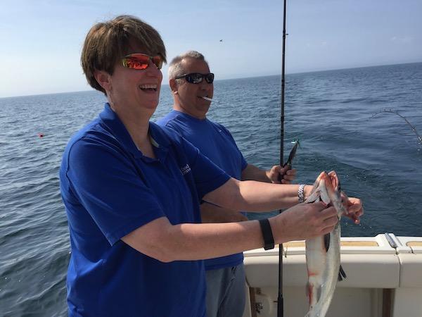 Sue Catching Coho Salmon up in Kenosha